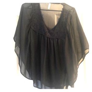 Sheer black top with butterfly wing sleeves